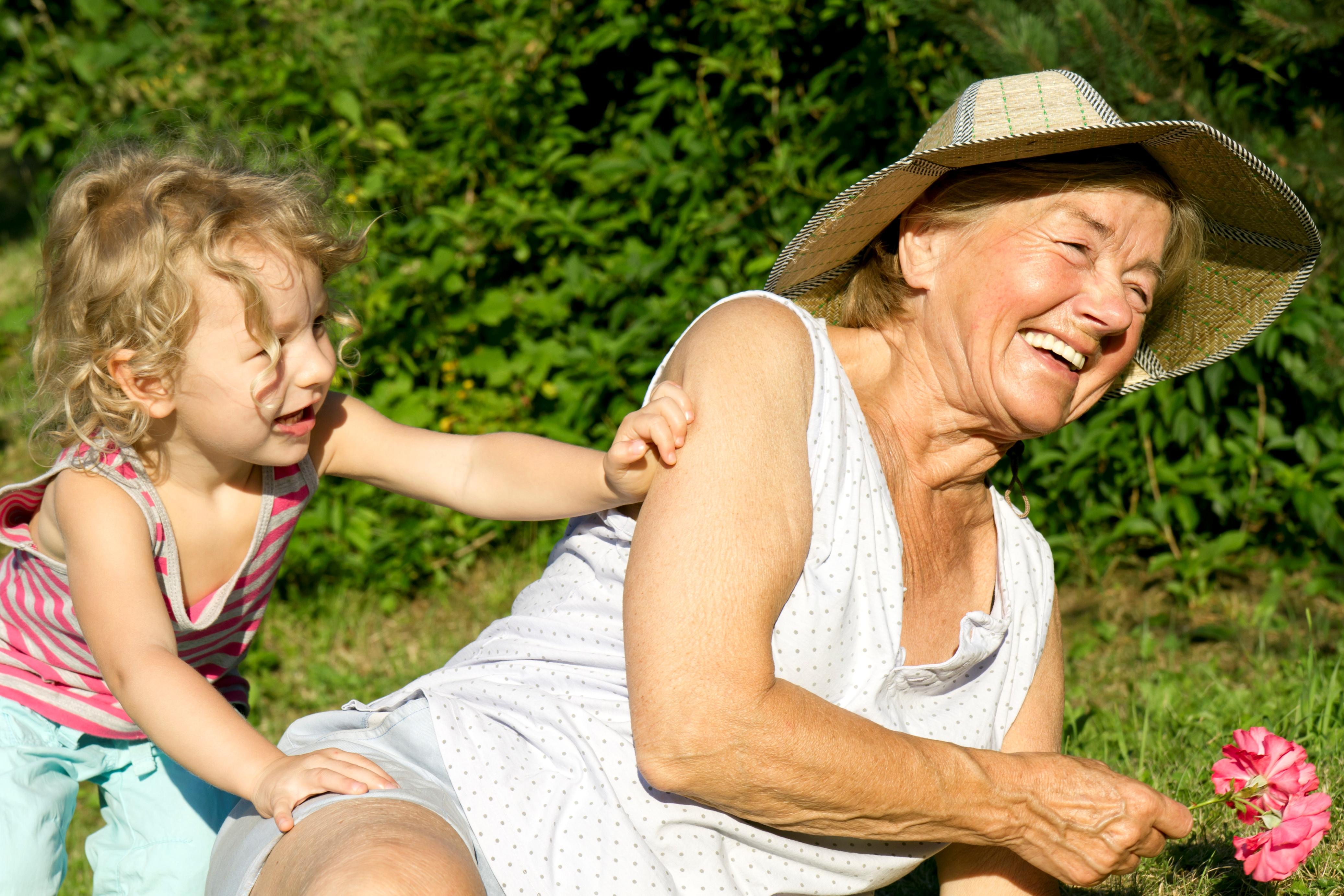 Grandma & Child Weeding Women Garden